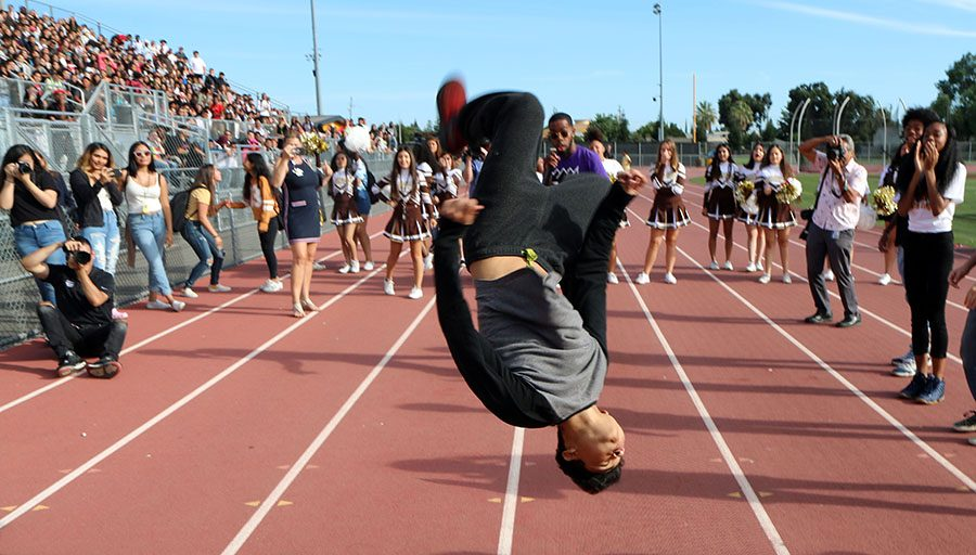 Senior Erick Chavez shows off his back flip while performing in the dance off.