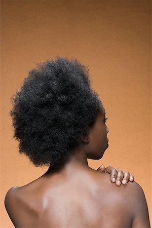 614-01820056 Model Release: Yes Property Release: No Rear view of a woman with afro hair